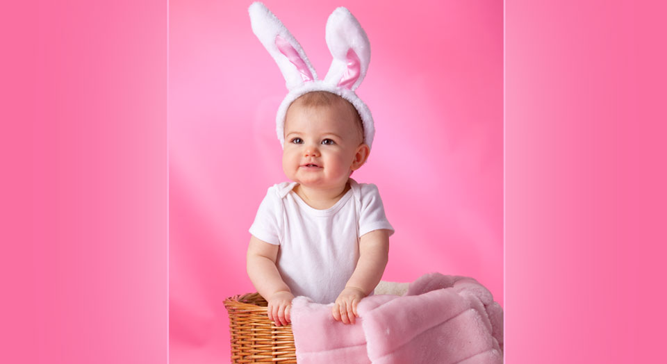 Adorable Professional Baby Photography of a baby girl in bunny ears and a pink setting