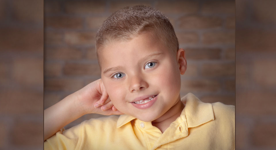 Professional Child Photography of a relaxed posed young boy