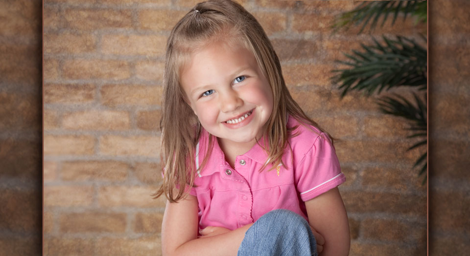 Child Photography of a young girl in a pink shirt
