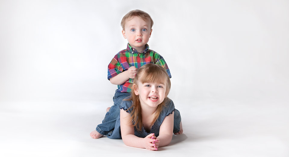Childrens photography of siblings on white in a photo studio setting