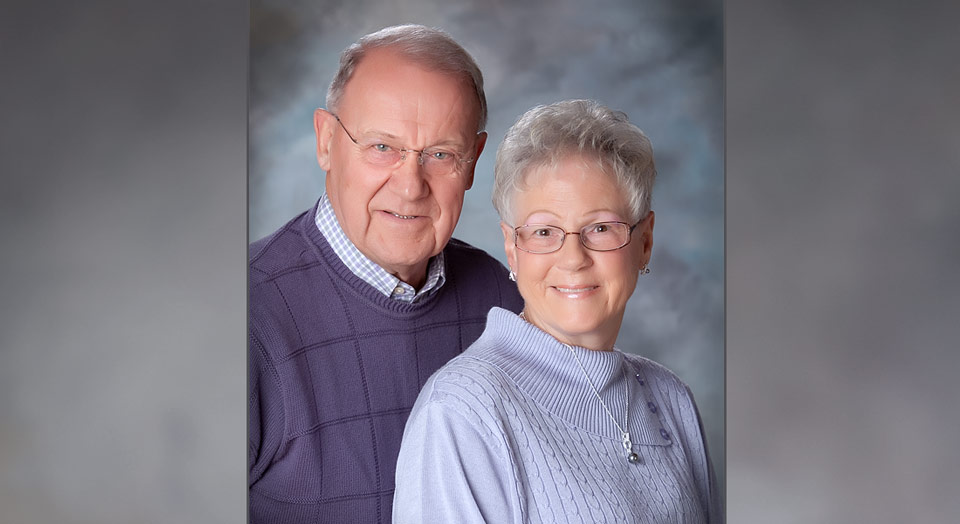 Traditional studio photography of older couple with professional lighting