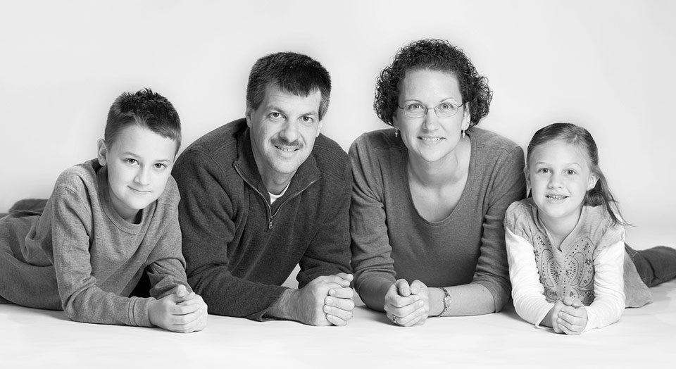 Casual studio style Jenison family photography of family on white background