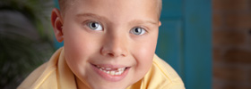 Children's Professional portrait of of a smiling boy with missing front teeth