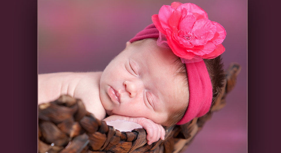 Newborn baby professional photography in a weave basket