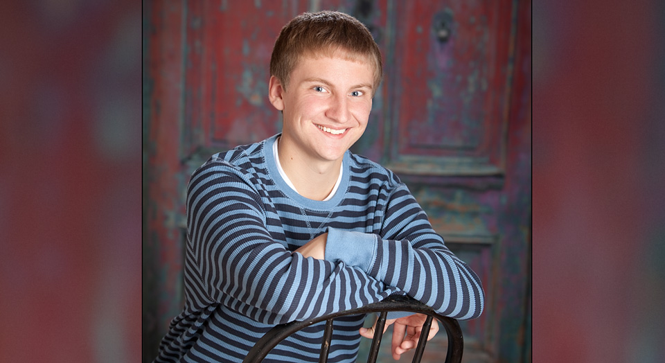 Senior Photography of high school boy in a studio on a multi-colored urban style background